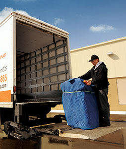 TTR Shipping employee loading truck for office moving